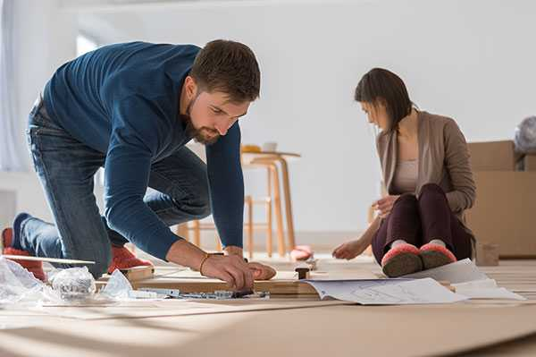 Couple putting furniture together
