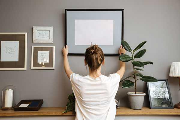 Woman Putting up Art