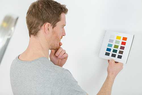 Man looking at paint colors