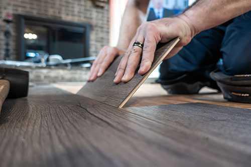 Man installing floor