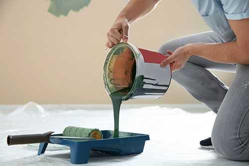 Man pouring paint